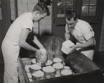 Two students working in creamery