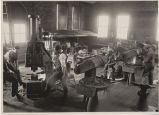 Students working in forge shop