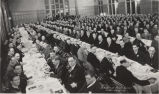 Men sitting at banquet tables