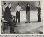 Mathematics students working at the blackboard