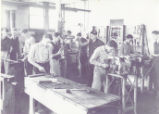 Men working in agricultural engineering workshop