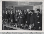 President Hovde and others in laboratory