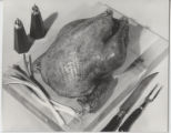 Close-up of roasted poultry on cutting  board