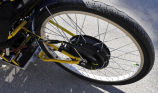 Close-up of back wheel on electric tricycle