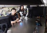 Chang Lu and student in laboratory
