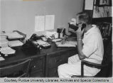 Man on telephone in office
