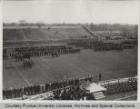 Military troops standing in outdoor stadium