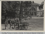Military personnel with artillery in front of Purdue building