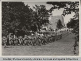 Military band marching on campus