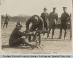 Military personnel with artillery during inspection
