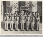 Group portrait of military personnel standing in front of building