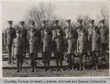 Group portrait of military personnel standing outside