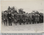 President Elliott and others standing at military inspection
