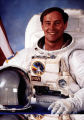 Jerry Ross posing in space suit