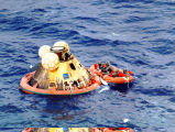 Space capsule floating in ocean