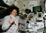 Mary Ellen Weber working aboard space shuttle
