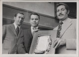 Eric C. Oesterle receives plaque