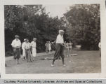 George Ade teeing off