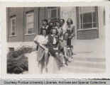Margaret Ulrey and group of classmates in front of campus building