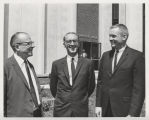 Neil Armstrong, standing with two Purdue administrators