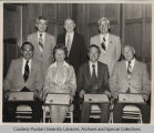 Purdue Alumni Association members, some seated with certificates
