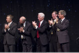 Purdue alumni astronauts standing and clapping at Armstrong dinner