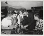 Gus Grissom signing autographs for fans