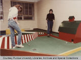 Students playing miniature golf