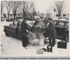 Students and automobile in winter