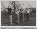 Four men arching bows