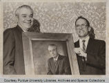 Erskine V. Morse and  Larry Shaeuffer, holding portrait painting