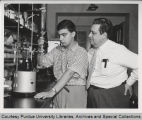 Herbert Brown working with student in laboratory