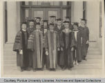 Stanley Coulter standing with others, posing in robes