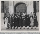 Dr. Lillian Gilbreth standing with speakers at W.S.G.A. Women's Vocational Conference