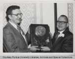 George A. Hawkins receiving plaque
