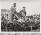 Erick Holm and woman at grave of John Purdue
