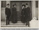 William C. Latta, standing in front of building with others