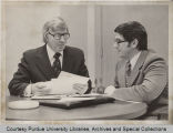 William L. Meier conferring with John P. Huston