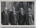 A.A. Potter standing with others at conference