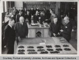 A.A. Potter, standing with others in laboratory of civil engineering building