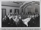 A.A. Potter, seated with others at formal dinner