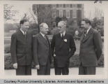 A.A. Potter, standing with President Elliott and others