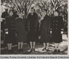 Dorothy Stratton standing with Mrs. Roosevelt and others