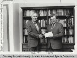 Dennis Weidenaar receiving grant money