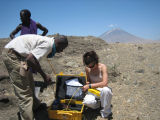 Sarah D. Stamps and Elifuraha Saria install equipment in Tanzania