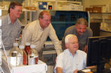 Tim and Ed Woenker with others, working on computer