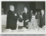 Unidentified person receiving award
