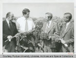 President Arthur G. Hansen and others with crops