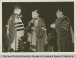 William A. Hillenbrand receives the symbolic hood of the doctor of laws degree