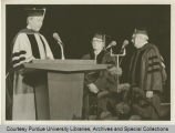 Herbert F. Rogers receives the symbolic hood of the doctor of engineering degree